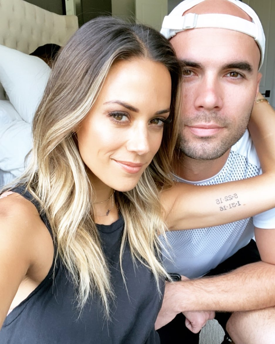 Jana Kramer huddles up husband Mike Caussin after topless photo thing